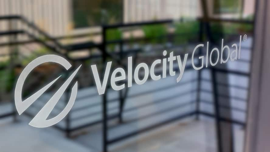 Velocity Global logo on our front door